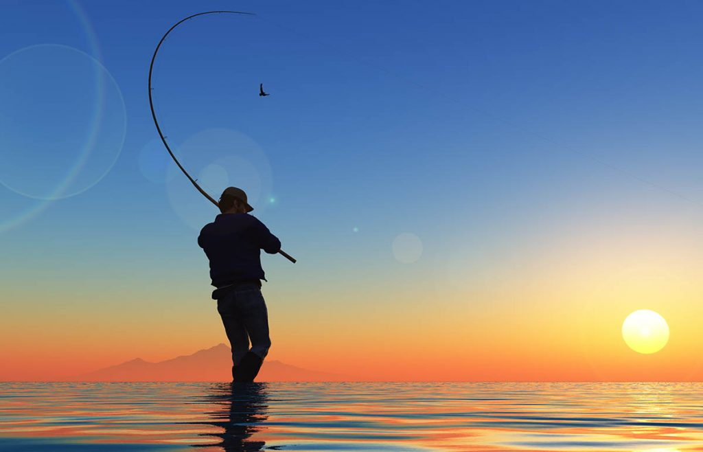 Fishing alone at sunset